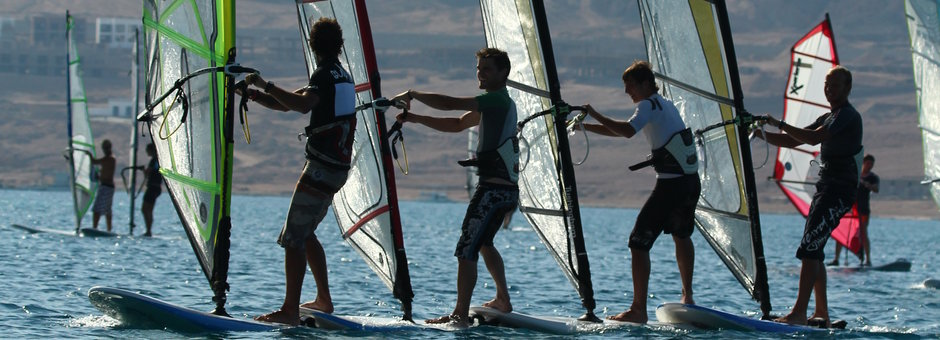 Wind surfing instructors on the water