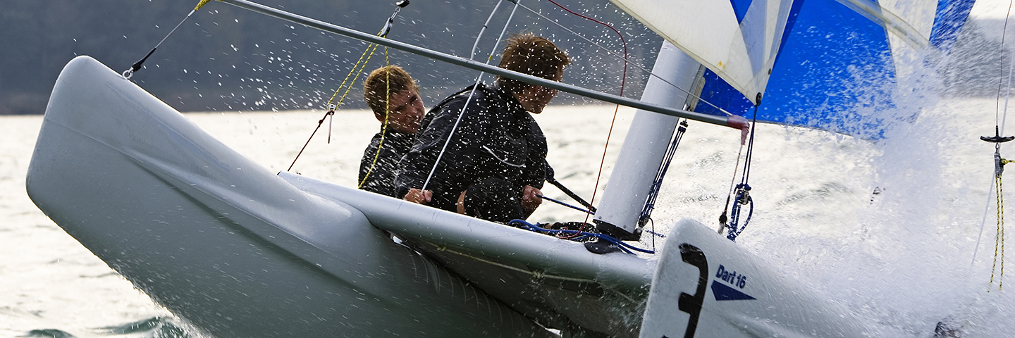 Instructors teaching inside a small multi-hull boat