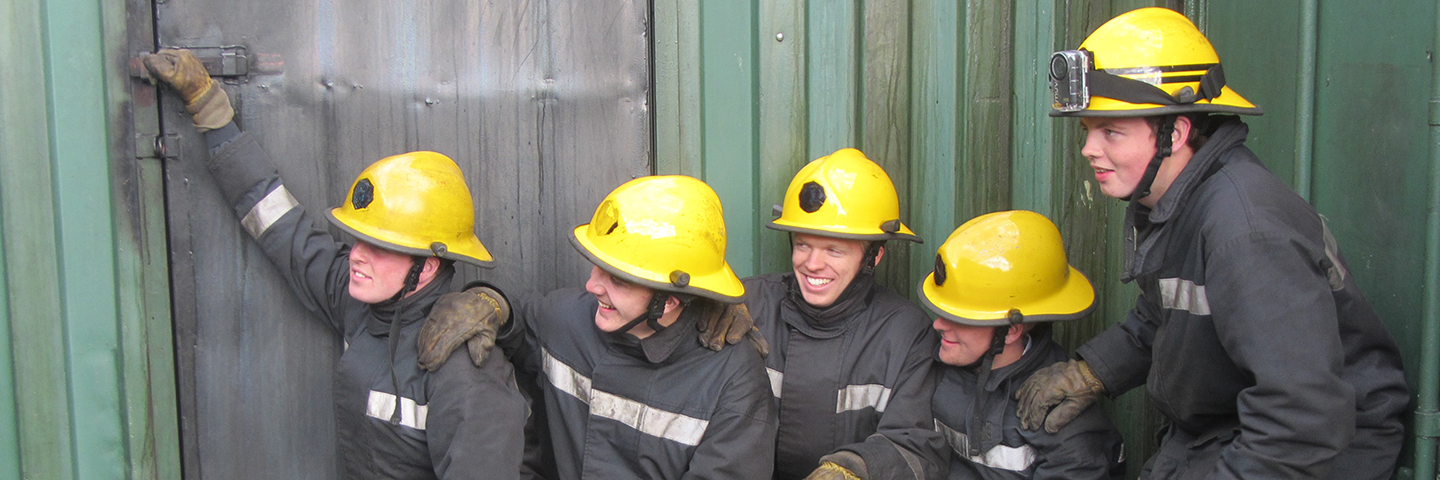 STCW students in fire-fighting safety equipment