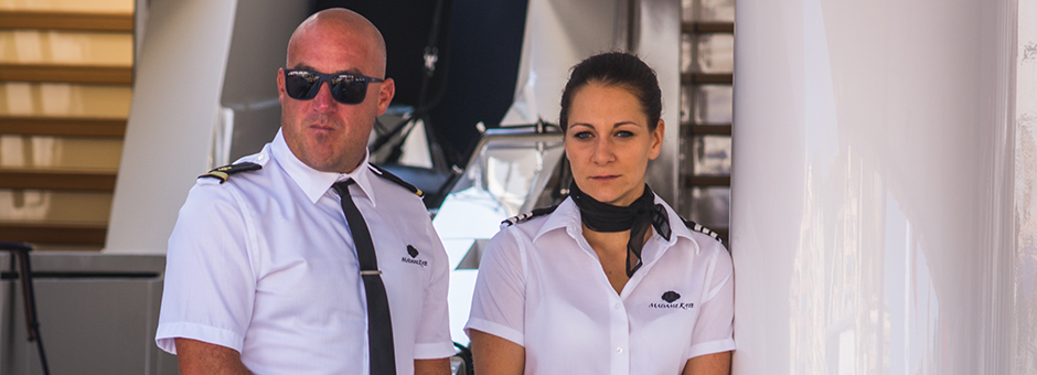 A male and female deckhand onboard a superyacht