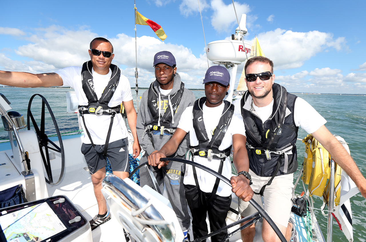 COWES, ENGLAND - AUGUST 06: L_R, Elroy Palmer, Reagan Joseph-Henry, Kirk Read of St. Giles Trust with UKSA CEO Ben Willows (R) during Aberdeen Asset Management Cowes Week on August 6, 2016 in Cowes, England. (Photo by Alan Crowhurst/Getty Images) *** Local Caption ***