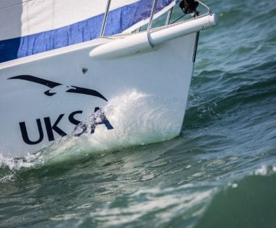 A UKSA training yacht cutting through water