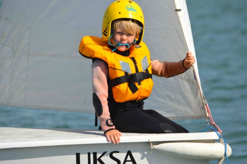 A young child on the bow of a dinghy