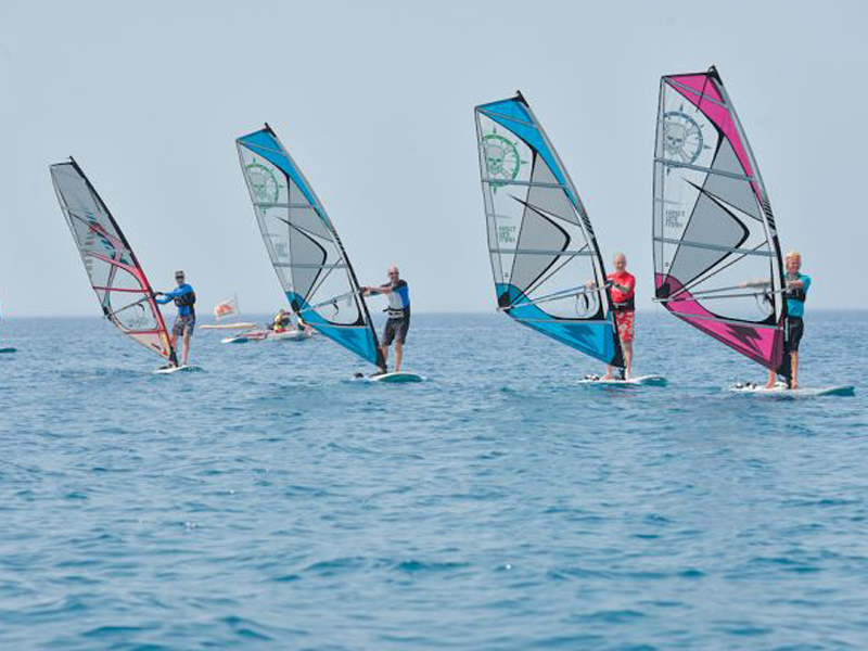 Jack Hill windsurfing with other UKSA students