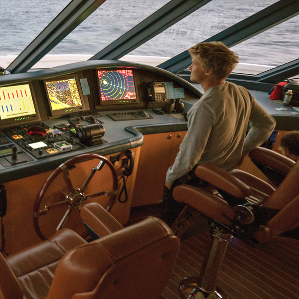 Superyacht Cadet at the helm