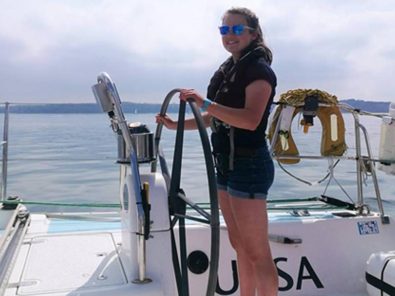 Rachel Brazier navigating a yacht
