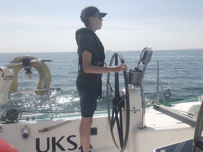 Royal Navy Sea Scouts onboard a yacht learning navigation