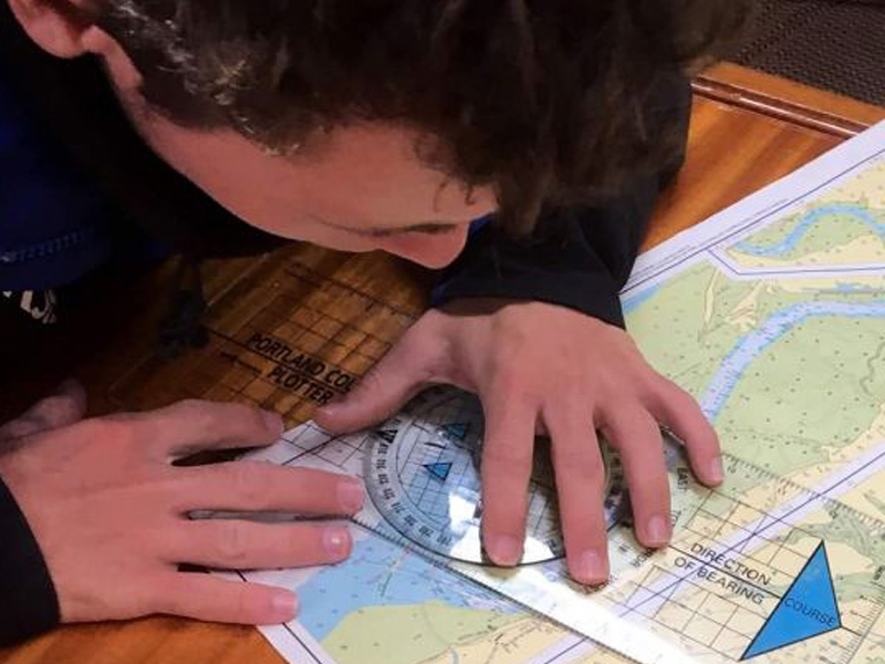 Sean Starkey working on navigation and course plotting on his course