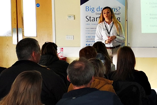 A UKSA instructor delivers a presentation about sailing careers.