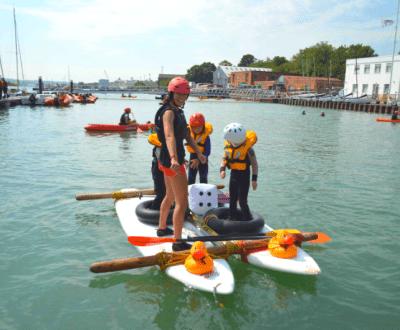Mini fun camp children on a raft
