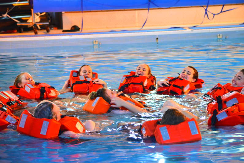 Students in the swimming pool learning sea safety
