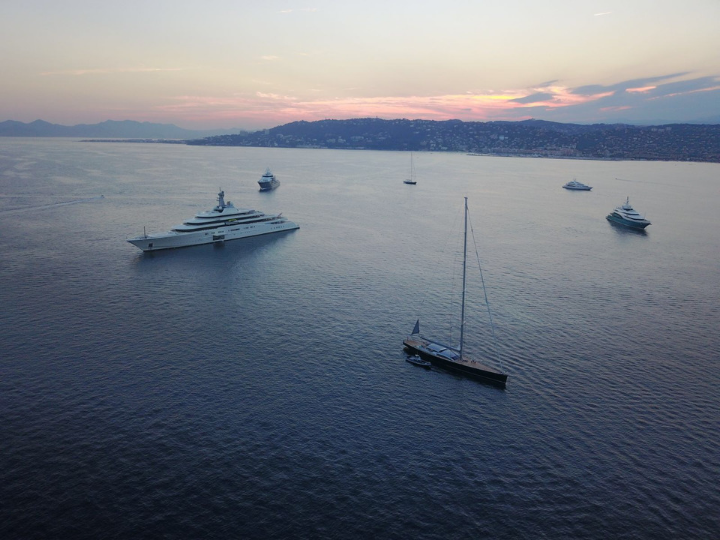 Superyacht anchored with sunset