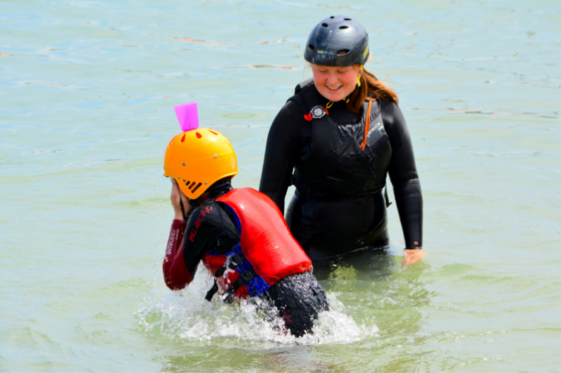 Watersports Instructor Development Programme student with visiting children