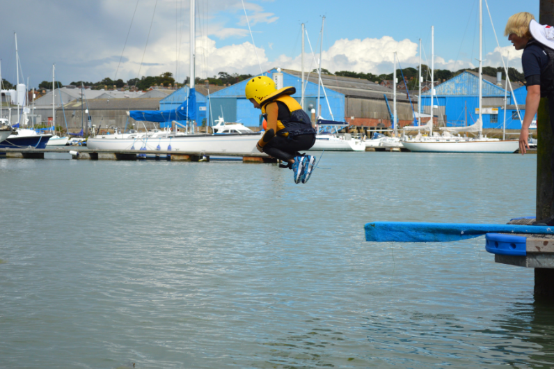 A child jumping off the pontoon