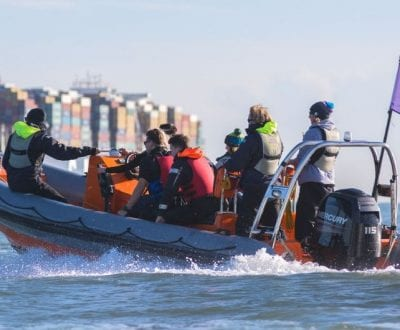 Multiple people onboard a powerboat on the Solent