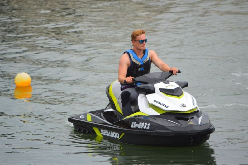Person on a stationary jet ski in calm water