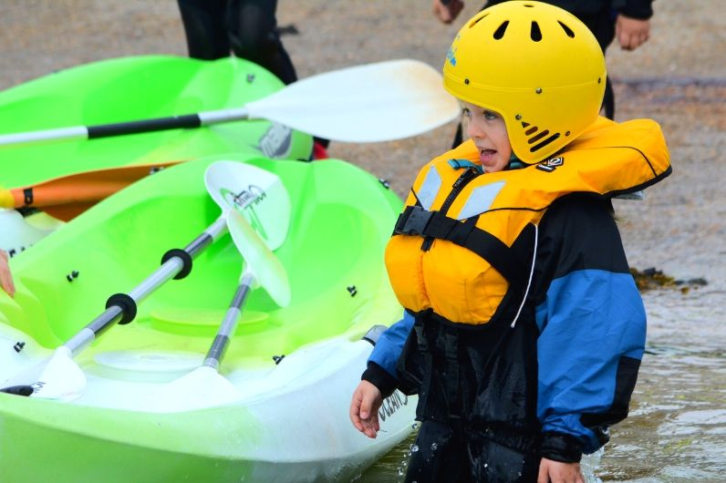 A young child enjoying the water on the UKSA Slipway