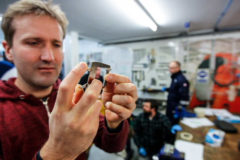 A student measuring a bolt on the MCA Approved Engine Course (AEC) course