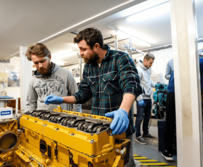 Students working on an engine on the MCA Approved Engine Course (AEC) course