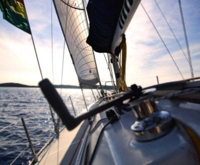 A Sailing yacht tilting as it navigates during the competent crew course