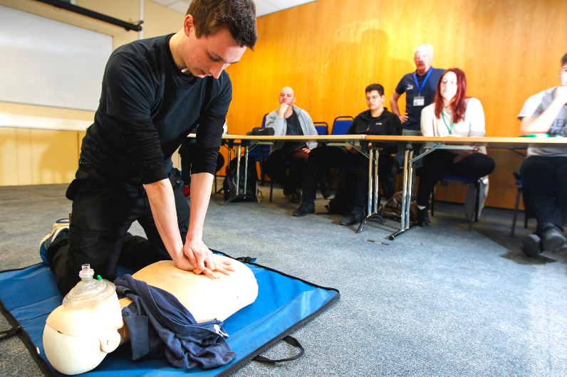 Student learning CPR on the Elementary First Aid Course