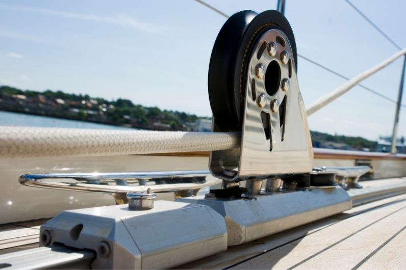 Rope being fed through a wheel onboard a yacht