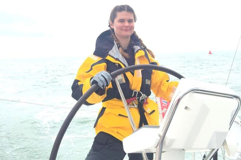 Female student sailing a yacht