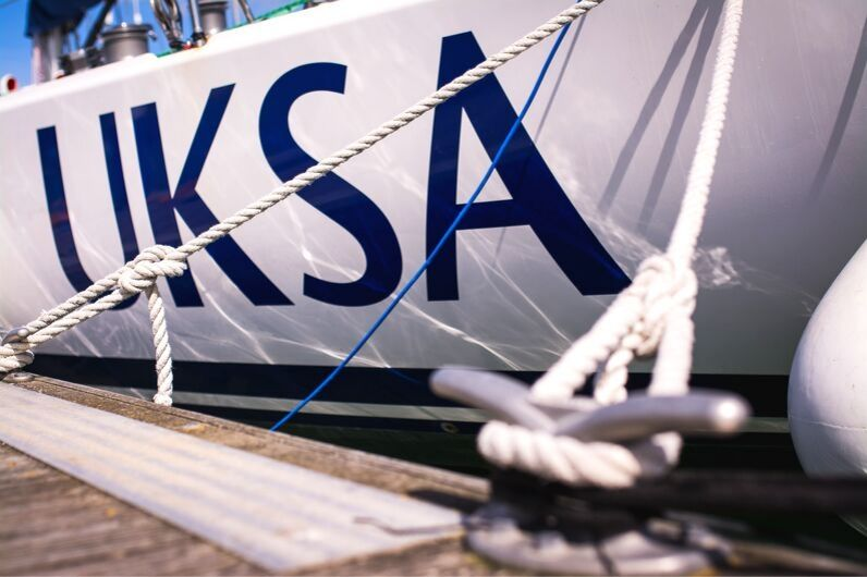Close up of a UKSA yacht used for sailing instruction.