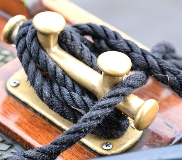 A close up of rope tied to a metal holder