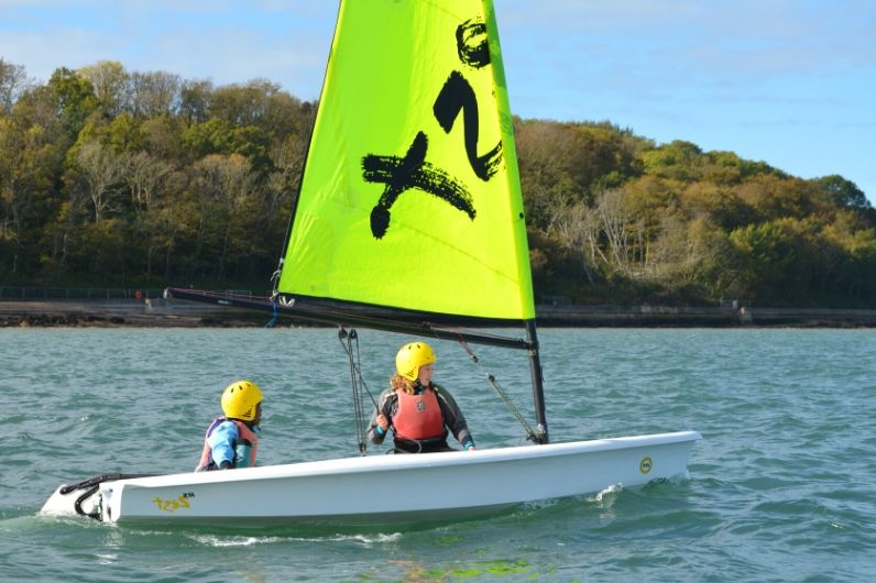 Two children participating in dinghy sailing
