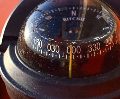 A compass onboard a yacht