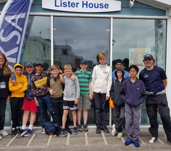 A group of young children posing infront of Lister building at UKSA