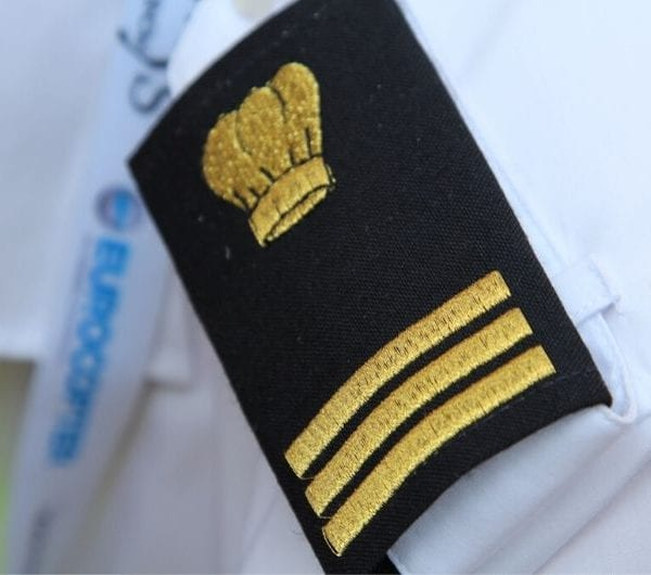 A close up of a naval officers epaulette