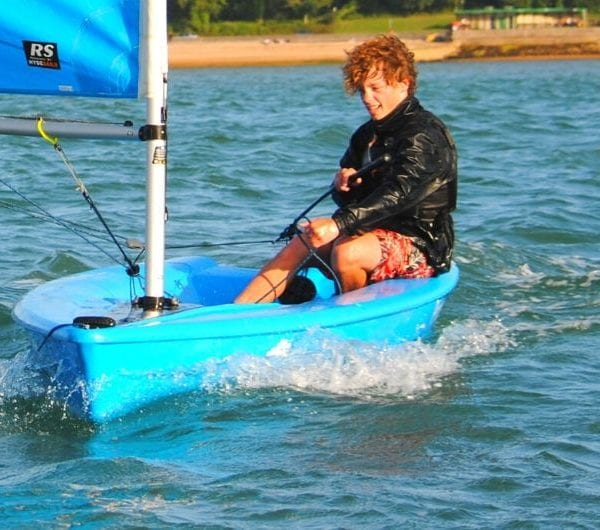 A young male UKSA students enjoying dinghy sailing