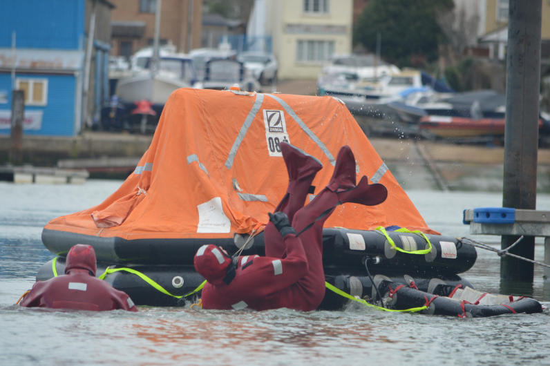 Students learning how to embark from a life raft