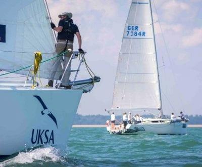 A UKSA trained sailor navigates a yacht.