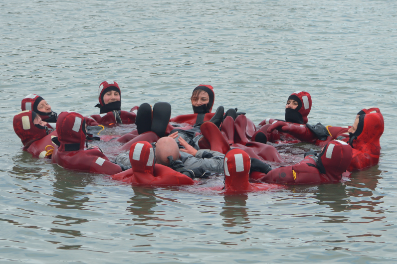 Students learning sea survival in the Solent