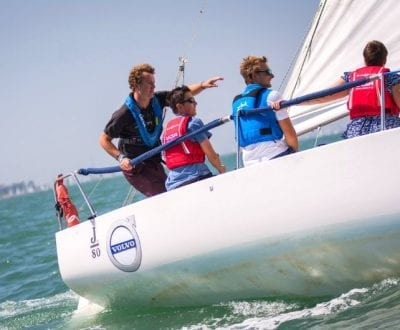 RYA Keelboat instructor teaching students at sea on Keelboat