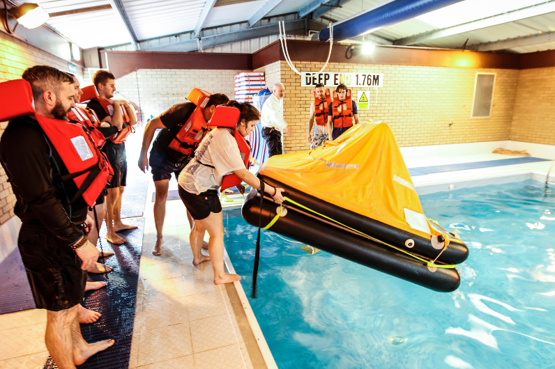 Students launching a survival craft on their Personal Survival Techniques Course