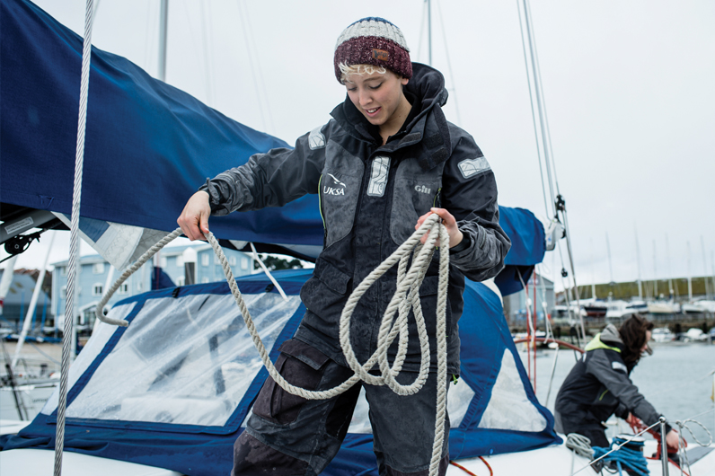 A cadet form the The Professional Yachtmaster Course mastering their rope skills