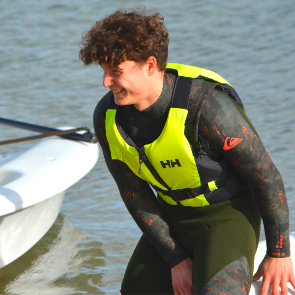A young watersports instructor with a life jacket on