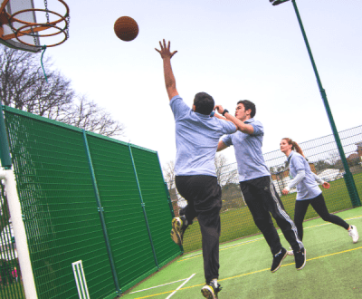 Further education students playing basketball