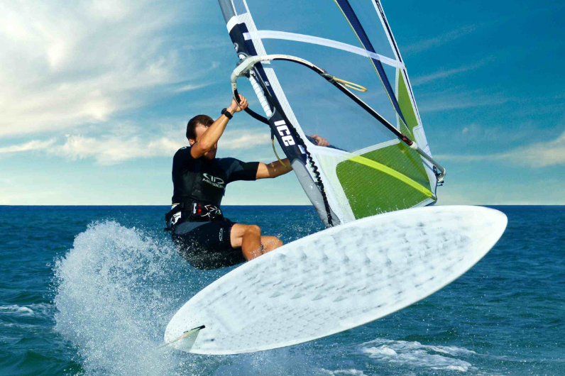A student learning to windsurf
