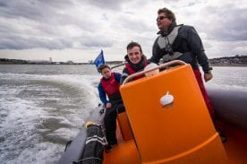 A powerboat instructor teaching students
