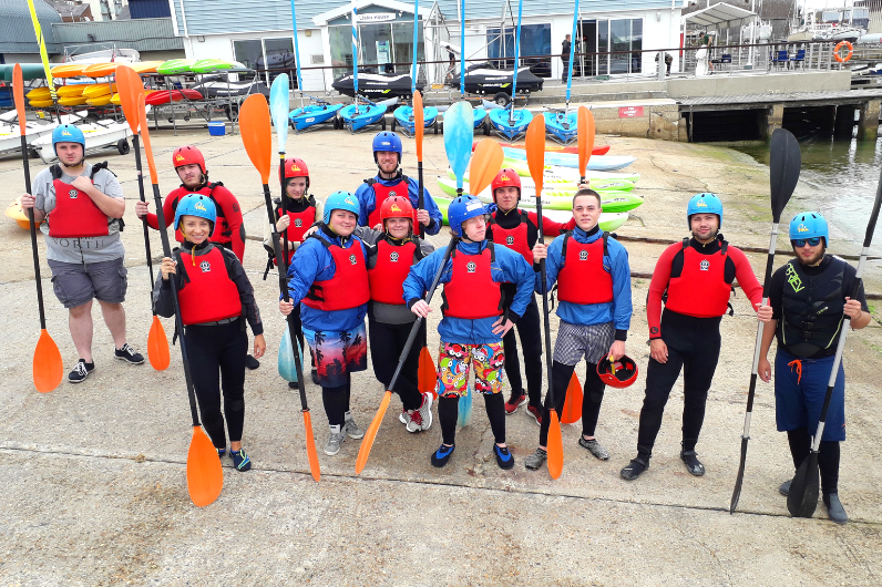 Activity group preparing for a UKSA watersports activity.