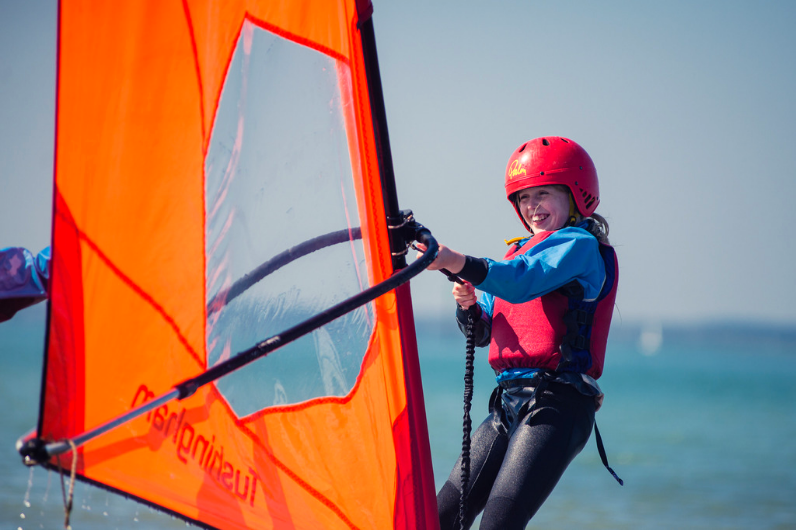 Polly's Challenge participant enjoying windsurfing