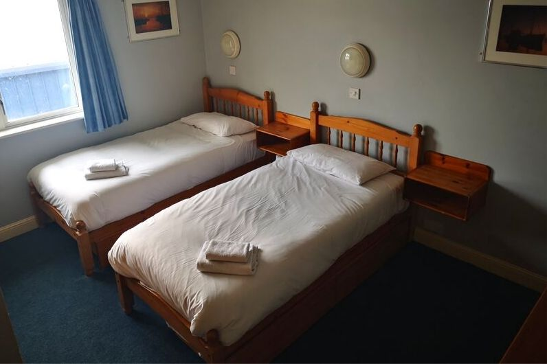 Lister accommodation room showing twin beds