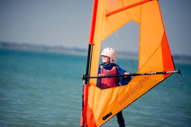 A school child learning to windsurf in Thorness Bay