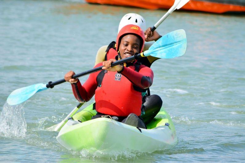 Children learning to kayak