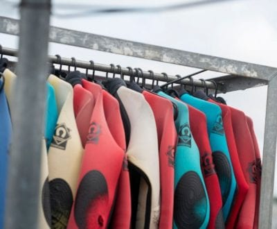 Wet-suits hanging out to dry